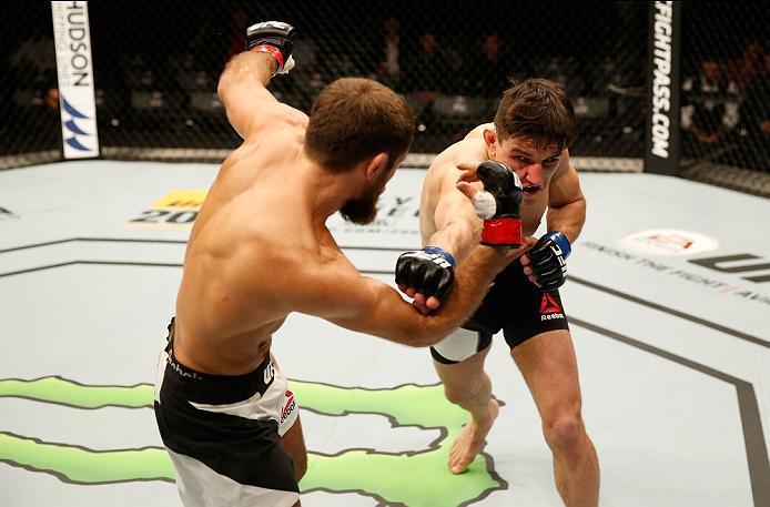 ZAGREB, CROATIA - APRIL 10:   (R-L) Damir Hadzovic punches Mairbek Taisumov in their lightweight bout during the UFC Fight Night event at the Arena Zagreb on April 10, 2016 in Zagreb, Croatia. (Photo by Srdjan Stevanovic/Zuffa LLC/Zuffa LLC via Getty Imag