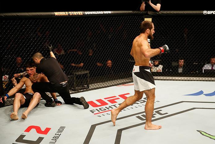 ZAGREB, CROATIA - APRIL 10:   (R-L) Mairbek Taisumov celebrates his knockout victory over Damir Hadzovic in their lightweight bout during the UFC Fight Night event at the Arena Zagreb on April 10, 2016 in Zagreb, Croatia. (Photo by Srdjan Stevanovic/Zuffa