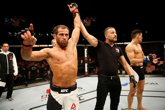 ZAGREB, CROATIA - APRIL 10:   (L-R) Mairbek Taisumov celebrates his knockout victory over Damir Hadzovic in their lightweight bout during the UFC Fight Night event at the Arena Zagreb on April 10, 2016 in Zagreb, Croatia. (Photo by Srdjan Stevanovic/Zuffa