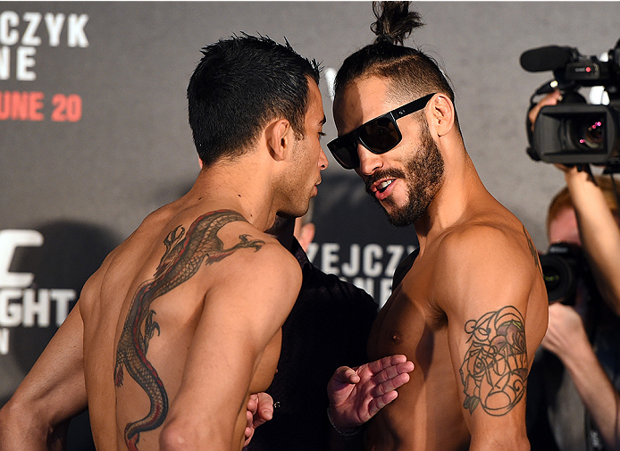 BERLIN, GERMANY - JUNE 19:   (L-R) Opponents Makwan Amirkhani of Finland and Masio Fullen of Mexico face off during the UFC Berlin weigh-in at the O2 World on June 19, 2015 in Berlin, Germany. (Photo by Josh Hedges/Zuffa LLC/Zuffa LLC via Getty Images)