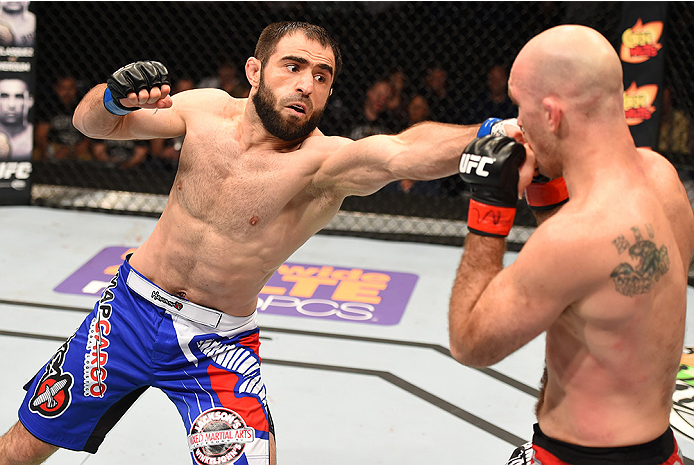 NEW ORLEANS, LA - JUNE 06:   (L-R) Omari Akhmedov punches Brian Ebersole in their welterweight bout during the UFC event at the Smoothie King Center on June 6, 2015 in New Orleans, Louisiana. (Photo by Josh Hedges/Zuffa LLC/Zuffa LLC via Getty Images)