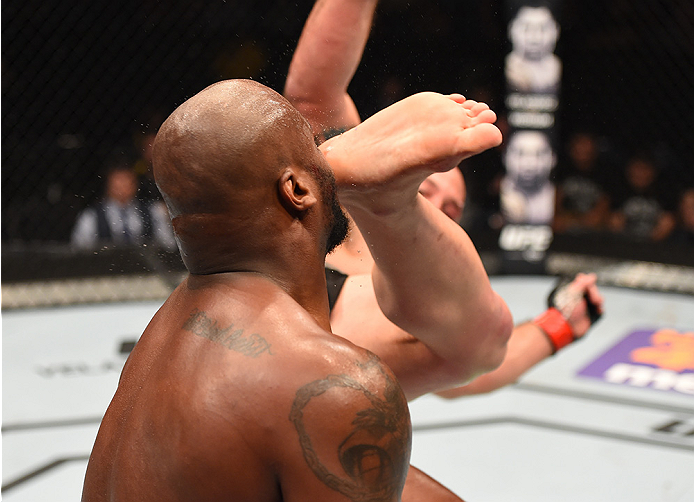 NEW ORLEANS, LA - JUNE 06:   Shawn Jordan kicks Derrick Lewis in their heavyweight bout during the UFC event at the Smoothie King Center on June 6, 2015 in New Orleans, Louisiana. (Photo by Josh Hedges/Zuffa LLC/Zuffa LLC via Getty Images)