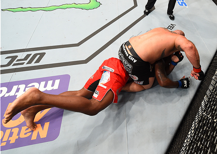 NEW ORLEANS, LA - JUNE 06:   Shawn Jordan (top) punches Derrick Lewis in their heavyweight bout during the UFC event at the Smoothie King Center on June 6, 2015 in New Orleans, Louisiana. (Photo by Josh Hedges/Zuffa LLC/Zuffa LLC via Getty Images)
