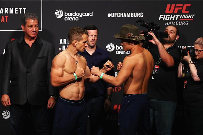 HAMBURG, GERMANY - SEPTEMBER 02:  Tae Hyun Bang of South Korea and Nick Hein of Germany come face to face during the UFC Fight Night Weigh-in held at Barclaycard Arena on September 2, 2016 in Hamburg, Germany.  Andrei 'The Pit Bull' Arlovski and Josh 'The