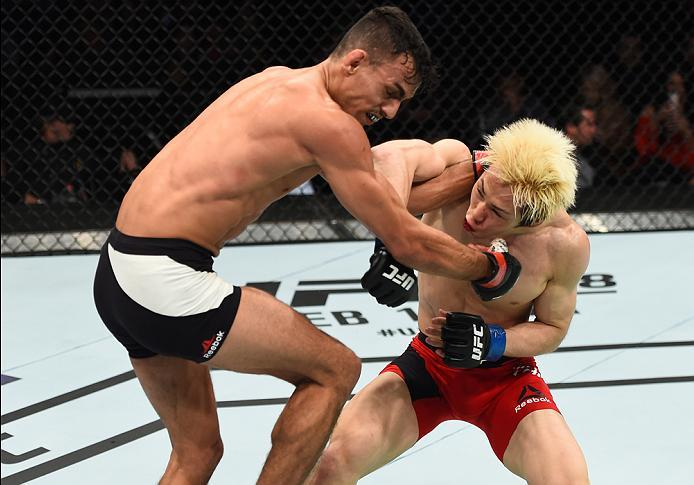 HOUSTON, TX - FEBRUARY 04:  (R-L) Michinori Tanaka of Japan punches Ricardo Ramos of Brazil in their bantamweight bout during the UFC Fight Night event at the Toyota Center on February 4, 2017 in Houston, Texas. (Photo by Jeff Bottari/Zuffa LLC/Zuffa LLC