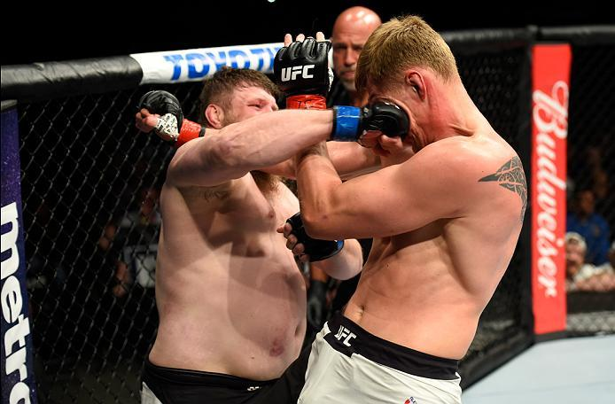 KANSAS CITY, MO - APRIL 15:  (L-R) Roy Nelson punches Alexander Volkov of Russia in their heavyweight fight during the UFC Fight Night event at Sprint Center on April 15, 2017 in Kansas City, Missouri. (Photo by Josh Hedges/Zuffa LLC/Zuffa LLC via Getty I