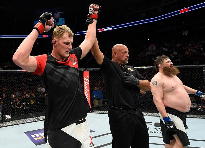 KANSAS CITY, MO - APRIL 15:  (L-R) Alexander Volkov of Russia celebrates his victory over Roy Nelson in their heavyweight fight during the UFC Fight Night event at Sprint Center on April 15, 2017 in Kansas City, Missouri. (Photo by Josh Hedges/Zuffa LLC/Z