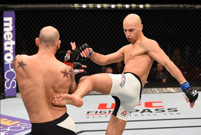 NEWARK, NJ - JANUARY 30:  (R-L) Alexander Yakovlev kicks George Sullivan in their welterweight bout during the UFC Fight Night event at the Prudential Center on January 30, 2016 in Newark, New Jersey. (Photo by Josh Hedges/Zuffa LLC/Zuffa LLC via Getty Im