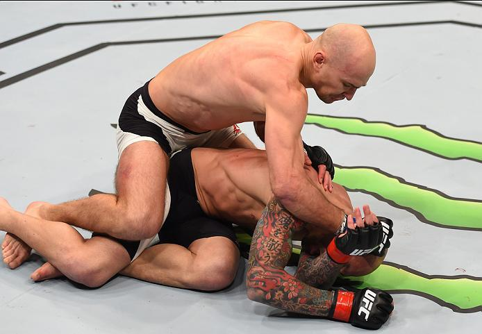 NEWARK, NJ - JANUARY 30:  Alexander Yakovlev (top) punches George Sullivan in their welterweight bout during the UFC Fight Night event at the Prudential Center on January 30, 2016 in Newark, New Jersey. (Photo by Josh Hedges/Zuffa LLC/Zuffa LLC via Getty
