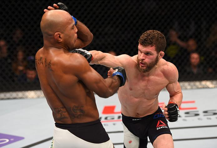 NEWARK, NJ - JANUARY 30:  (R-L) Dustin Ortiz punches Wilson Reis in their flyweight bout during the UFC Fight Night event at the Prudential Center on January 30, 2016 in Newark, New Jersey. (Photo by Josh Hedges/Zuffa LLC/Zuffa LLC via Getty Images)