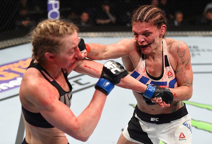 PITTSBURGH, PA - FEBRUARY 21:  (R-L) Lauren Murphy exchanges punches with Kelly Faszholz in their women's bantamweight bout during the UFC Fight Night event at Consol Energy Center on February 21, 2016 in Pittsburgh, Pennsylvania. (Photo by Jeff Bottari/Z