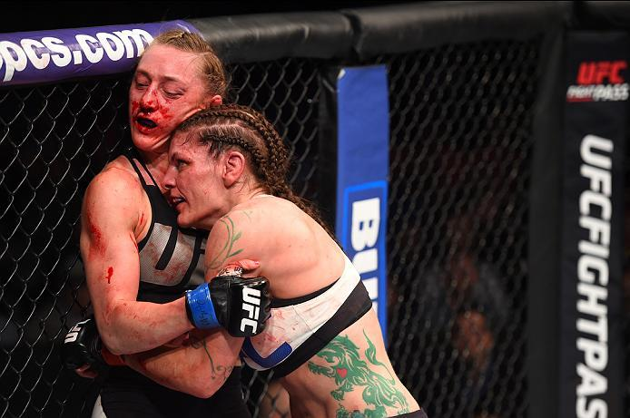 PITTSBURGH, PA - FEBRUARY 21:  (R-L) Lauren Murphy pushes Kelly Faszholz up against the cage in their women's bantamweight bout during the UFC Fight Night event at Consol Energy Center on February 21, 2016 in Pittsburgh, Pennsylvania. (Photo by Jeff Botta