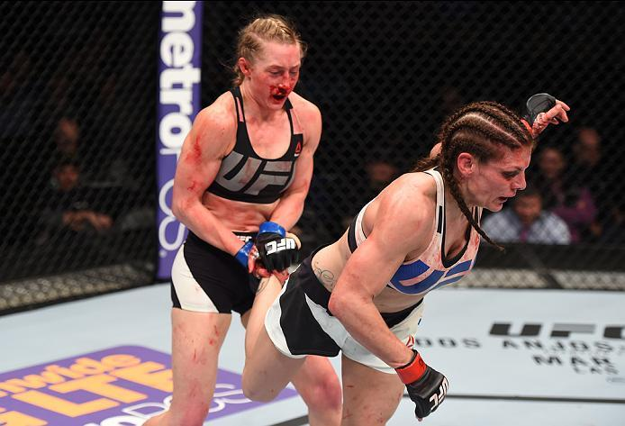 PITTSBURGH, PA - FEBRUARY 21:  (L-R) Kelly Faszholz attempts to take down Lauren Murphy in their women's bantamweight bout during the UFC Fight Night event at Consol Energy Center on February 21, 2016 in Pittsburgh, Pennsylvania. (Photo by Jeff Bottari/Zu