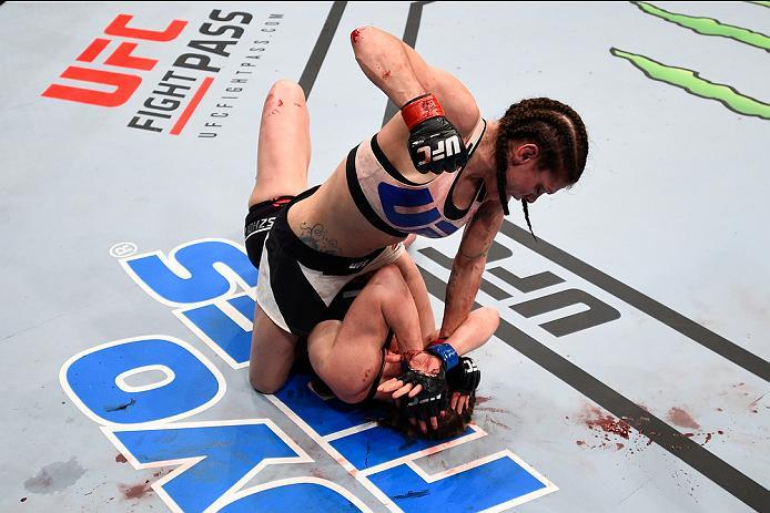 PITTSBURGH, PA - FEBRUARY 21:  Lauren Murphy (top) punches Faszholz in their women's bantamweight bout during the UFC Fight Night event at Consol Energy Center on February 21, 2016 in Pittsburgh, Pennsylvania. (Photo by Jeff Bottari/Zuffa LLC/Zuffa LLC vi