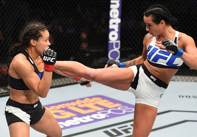 PITTSBURGH, PA - FEBRUARY 21:  (R-L) Ashlee Evans-Smith kicks Marion Reneau in their women's bantamweight bout during the UFC Fight Night event at Consol Energy Center on February 21, 2016 in Pittsburgh, Pennsylvania. (Photo by Jeff Bottari/Zuffa LLC/Zuff