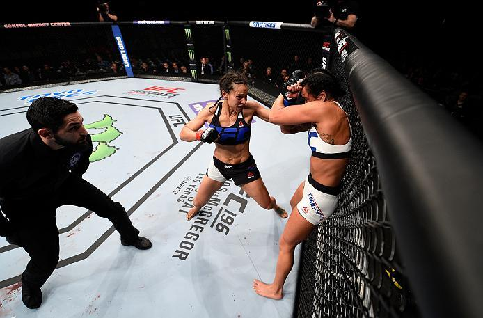 PITTSBURGH, PA - FEBRUARY 21:  (L-R) Marion Reneau punches Ashlee Evans-Smith in their women's bantamweight bout during the UFC Fight Night event at Consol Energy Center on February 21, 2016 in Pittsburgh, Pennsylvania. (Photo by Jeff Bottari/Zuffa LLC/Zu