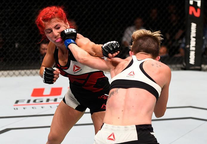 OTTAWA, ON - JUNE 18:   (R-L) Jocelyn Jones-Lybarger of the United States punches Randa Markos of Iraq in their women's strawweight bout during the UFC Fight Night event inside the TD Place Arena on June 18, 2016 in Ottawa, Ontario, Canada. (Photo by Jeff