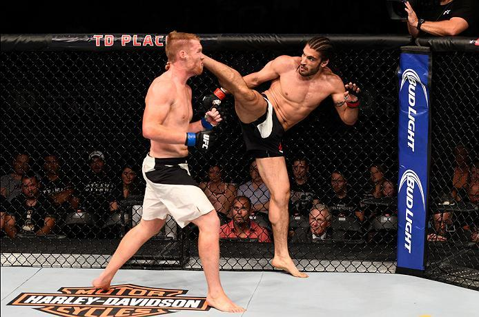 OTTAWA, ON - JUNE 18:   (R-L) Elias Theodorou of Canada kicks Sam Alvey of the United States in their middleweight bout during the UFC Fight Night event inside the TD Place Arena on June 18, 2016 in Ottawa, Ontario, Canada. (Photo by Jeff Bottari/Zuffa LL