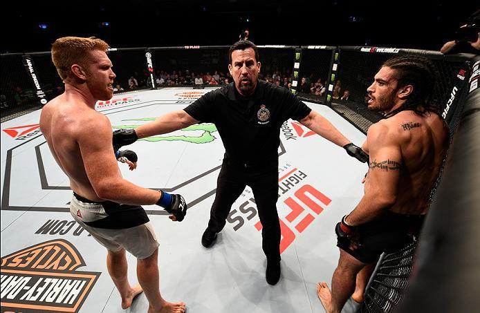 OTTAWA, ON - JUNE 18:   (R-L) Elias Theodorou of Canada and Sam Alvey of the United States are separated after their middleweight bout during the UFC Fight Night event inside the TD Place Arena on June 18, 2016 in Ottawa, Ontario, Canada. (Photo by Jeff B