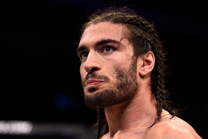 OTTAWA, ON - JUNE 18:   Elias Theodorou of Canada waits to hear the judges decision after facing Sam Alvey of the United States in their middleweight bout during the UFC Fight Night event inside the TD Place Arena on June 18, 2016 in Ottawa, Ontario, Cana