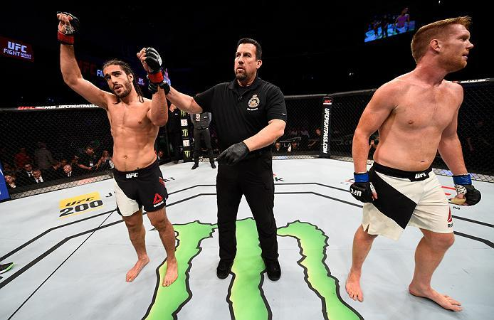 OTTAWA, ON - JUNE 18:   (L-R) Elias Theodorou of Canada celebrates his victory over Sam Alvey of the United States in their middleweight bout during the UFC Fight Night event inside the TD Place Arena on June 18, 2016 in Ottawa, Ontario, Canada. (Photo by
