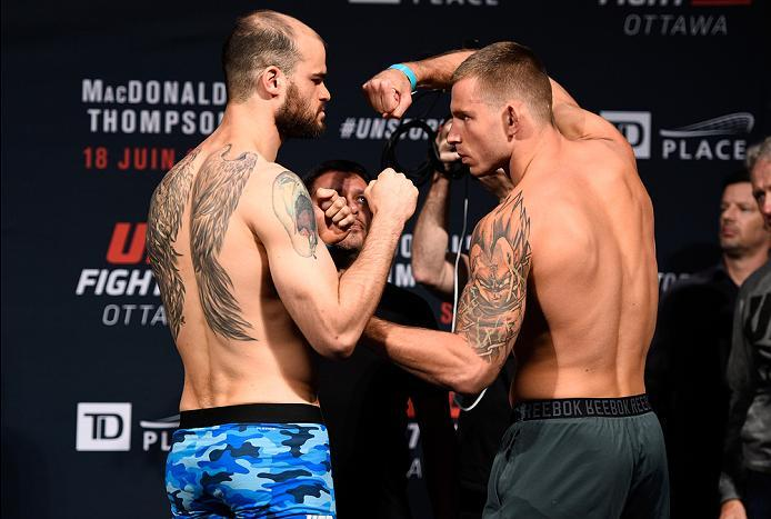 OTTAWA, ON - JUNE 17:  (L-R) Opponents Tamdan McCrory of the United States and Krzysztof Jotko of Poland face off during the UFC Fight Night Weigh-in inside the Arena at TD Place on June 17, 2016 in Ottawa, Ontario, Canada. (Photo by Jeff Bottari/Zuffa LL