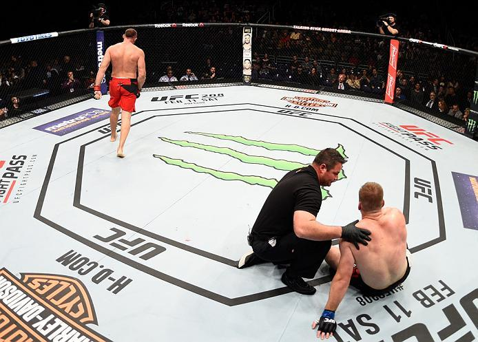 PHOENIX, AZ - JANUARY 15:  (L-R) Aleksei Oleinik of Russia celebrates his submission victory over Viktor Pesta of Czech Republic in their heavyweight bout during the UFC Fight Night event inside Talking Stick Resort Arena on January 15, 2017 in Phoenix, A