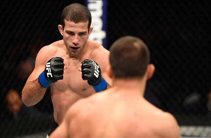 PHOENIX, AZ - JANUARY 15:  (L-R) Augusto Mendes of Brazil circles Frankie Saenz in their bantamweight bout during the UFC Fight Night event inside Talking Stick Resort Arena on January 15, 2017 in Phoenix, Arizona. (Photo by Jeff Bottari/Zuffa LLC/Zuffa L