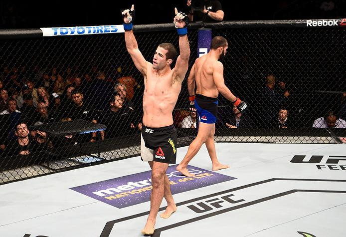 PHOENIX, AZ - JANUARY 15:  (L-R) Augusto Mendes of Brazil and Frankie Saenz raise their hands after their bantamweight bout during the UFC Fight Night event inside Talking Stick Resort Arena on January 15, 2017 in Phoenix, Arizona. (Photo by Jeff Bottari/