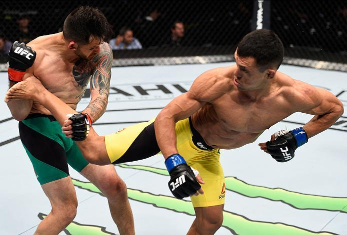 MEXICO CITY, MEXICO - NOVEMBER 05:  (R-L) Douglas Silva de Andrade of Brazil kicks Henry Briones of Mexico in their bantamweight bout during the UFC Fight Night event at Arena Ciudad de Mexico on November 5, 2016 in Mexico City, Mexico. (Photo by Jeff Bot