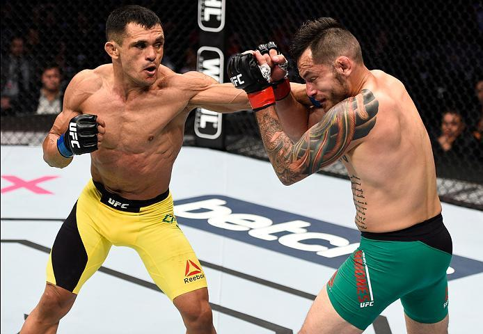 MEXICO CITY, MEXICO - NOVEMBER 05:  (L-R) Douglas Silva de Andrade of Brazil punches Henry Briones of Mexico in their bantamweight bout during the UFC Fight Night event at Arena Ciudad de Mexico on November 5, 2016 in Mexico City, Mexico. (Photo by Jeff B