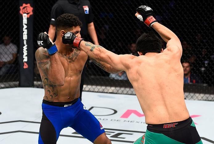 MEXICO CITY, MEXICO - NOVEMBER 05:  (R-L) Erick Montano of Mexico punches Max Griffin of the United States in their welterweight bout during the UFC Fight Night event at Arena Ciudad de Mexico on November 5, 2016 in Mexico City, Mexico. (Photo by Jeff Bot