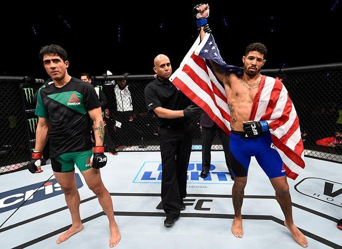 MEXICO CITY, MEXICO - NOVEMBER 05:  (R-L) Max Griffin of the United States celebrates his victory over Erick Montano of Mexico in their welterweight bout during the UFC Fight Night event at Arena Ciudad de Mexico on November 5, 2016 in Mexico City, Mexico