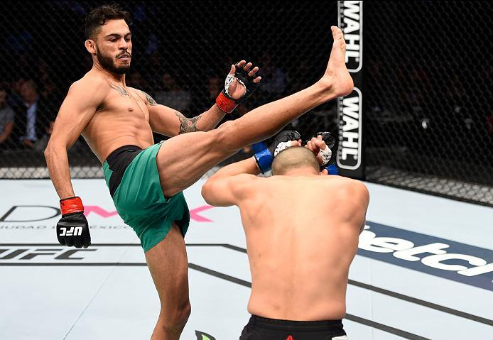 MEXICO CITY, MEXICO - NOVEMBER 05:  (L-R) Marco Beltran of Mexico kicks Joe Soto of the United States in their catchweight bout during the UFC Fight Night event at Arena Ciudad de Mexico on November 5, 2016 in Mexico City, Mexico. (Photo by Jeff Bottari/Z