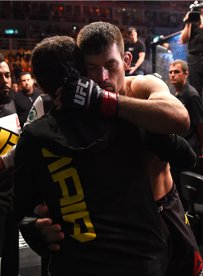 RIO DE JANEIRO, BRAZIL - AUGUST 01:  Demian Maia of Brazil hugs his teammate before entering the Octagon to face Neil Magny of the United States in their welterweight bout during the UFC 190 event inside HSBC Arena on August 1, 2015 in Rio de Janeiro, Bra