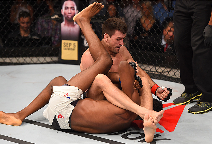RIO DE JANEIRO, BRAZIL - AUGUST 01:  Demian Maia of Brazil (top) attempts to submit Neil Magny of the United States in their welterweight bout during the UFC 190 event inside HSBC Arena on August 1, 2015 in Rio de Janeiro, Brazil.  (Photo by Josh Hedges/Z
