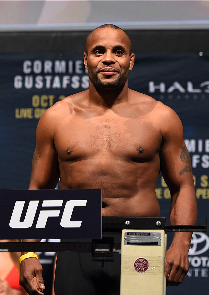 HOUSTON, TX - OCTOBER 02:  UFC light heavyweight champion Daniel Cormier steps on the scale during the UFC 192 weigh-in at the Toyota Center on October 2, 2015 in Houston, Texas. (Photo by Josh Hedges/Zuffa LLC/Zuffa LLC via Getty Images)