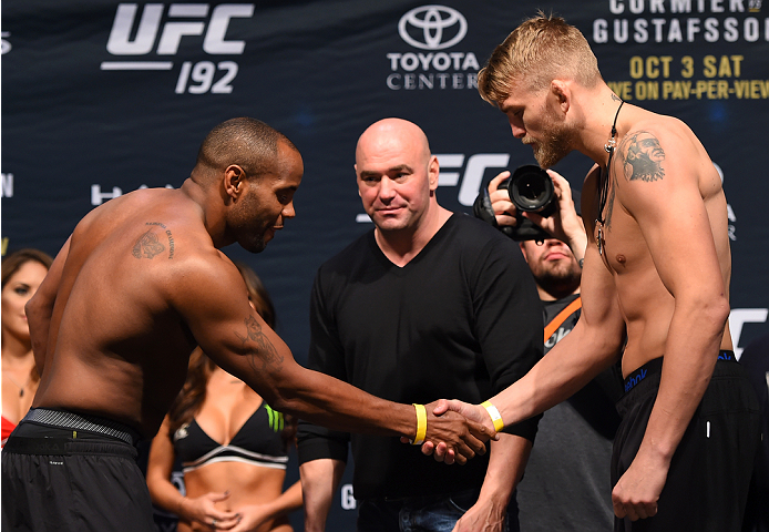 HOUSTON, TX - OCTOBER 02:  UFC light heavyweight champion Daniel Cormier and Alexander Gustafsson shake hands during the UFC 192 weigh-in at the Toyota Center on October 2, 2015 in Houston, Texas. (Photo by Josh Hedges/Zuffa LLC/Zuffa LLC via Getty Images