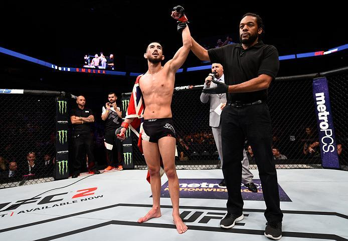 SIOUX FALLS, SD - JULY 13:   Louis Smolka celebrates his victory over Ben Nguyen in their flyweight bout during the UFC Fight Night event on July 13, 2016 at Denny Sanford Premier Center in Sioux Falls, South Dakota. (Photo by Jeff Bottari/Zuffa LLC/Zuffa