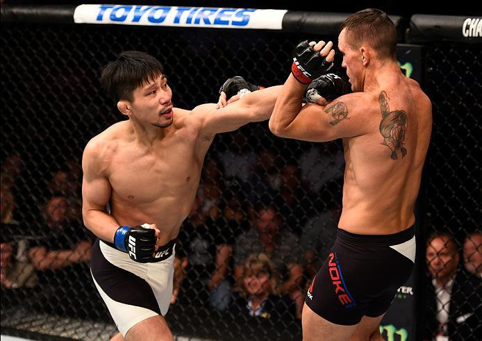 SIOUX FALLS, SD - JULY 13:   (L-R) Keita Nakamura punches Kyle Noke in their welterweight bout during the UFC Fight Night event on July 13, 2016 at Denny Sanford Premier Center in Sioux Falls, South Dakota. (Photo by Jeff Bottari/Zuffa LLC/Zuffa LLC via G