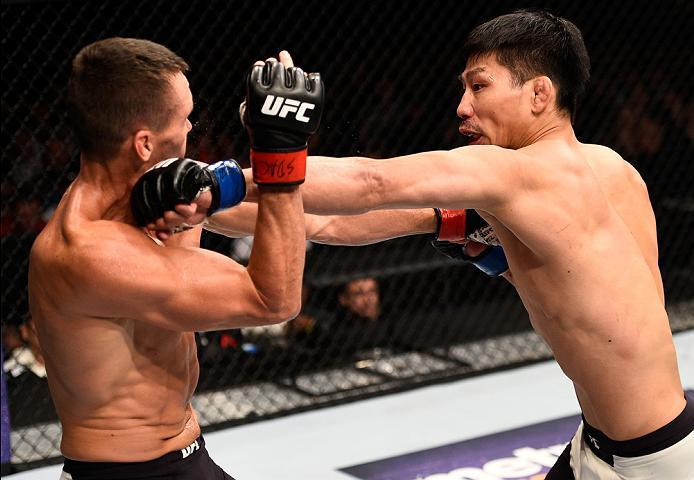 SIOUX FALLS, SD - JULY 13:   (R-L) Keita Nakamura punches Kyle Noke in their welterweight bout during the UFC Fight Night event on July 13, 2016 at Denny Sanford Premier Center in Sioux Falls, South Dakota. (Photo by Jeff Bottari/Zuffa LLC/Zuffa LLC via G