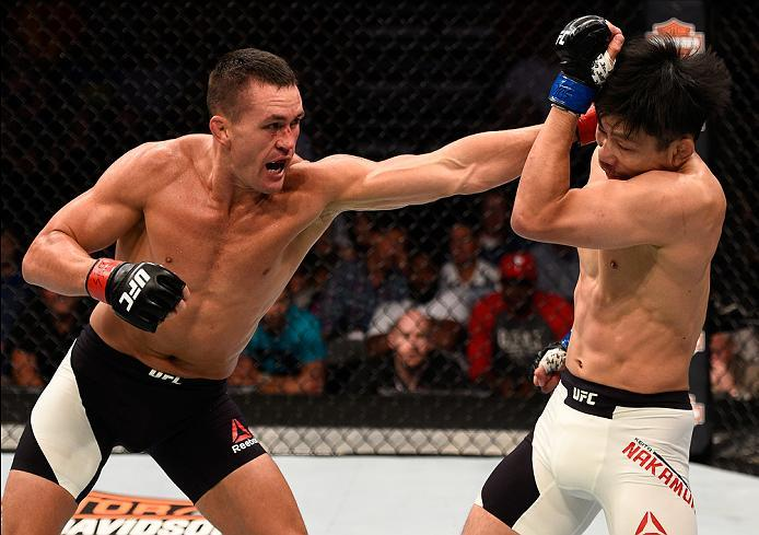 SIOUX FALLS, SD - JULY 13:   (L-R) Kyle Noke punches Keita Nakamura in their welterweight bout during the UFC Fight Night event on July 13, 2016 at Denny Sanford Premier Center in Sioux Falls, South Dakota. (Photo by Jeff Bottari/Zuffa LLC/Zuffa LLC via G
