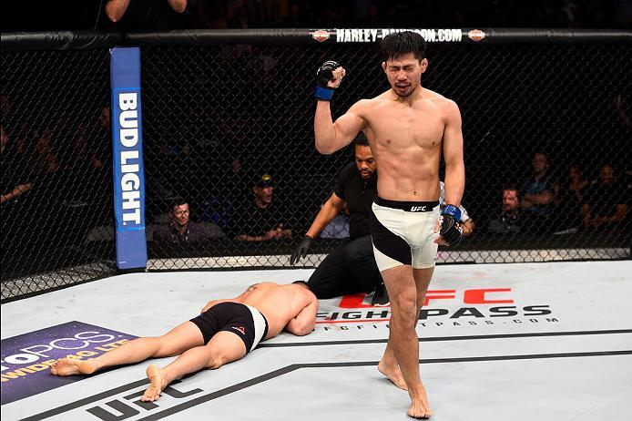 SIOUX FALLS, SD - JULY 13:   (R-L) Keita Nakamura celebrates his submission victory over Kyle Noke in their welterweight bout during the UFC Fight Night event on July 13, 2016 at Denny Sanford Premier Center in Sioux Falls, South Dakota. (Photo by Jeff Bo