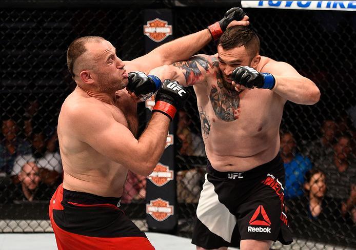 SIOUX FALLS, SD - JULY 13:   (R-L) Daniel Omielanczuk punches Aleksei Oleinik in their heavyweight bout during the UFC Fight Night event on July 13, 2016 at Denny Sanford Premier Center in Sioux Falls, South Dakota. (Photo by Jeff Bottari/Zuffa LLC/Zuffa