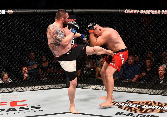 SIOUX FALLS, SD - JULY 13:   (L-R) Daniel Omielanczuk kicks Aleksei Oleinik in their heavyweight bout during the UFC Fight Night event on July 13, 2016 at Denny Sanford Premier Center in Sioux Falls, South Dakota. (Photo by Jeff Bottari/Zuffa LLC/Zuffa LL