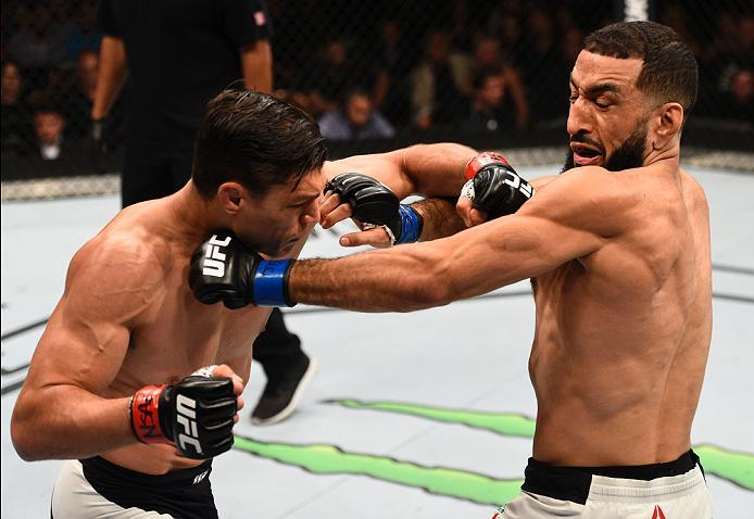 LAS VEGAS, NV - JULY 07:   (L-R) Alan Jouban punches Belal Muhammad in their welterweight bout during the UFC Fight Night event inside the MGM Grand Garden Arena on July 7, 2016 in Las Vegas, Nevada. (Photo by Jeff Bottari/Zuffa LLC/Zuffa LLC via Getty Im