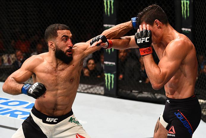 LAS VEGAS, NV - JULY 07:   (L-R) Belal Muhammad punches Alan Jouban in their welterweight bout during the UFC Fight Night event inside the MGM Grand Garden Arena on July 7, 2016 in Las Vegas, Nevada. (Photo by Jeff Bottari/Zuffa LLC/Zuffa LLC via Getty Im