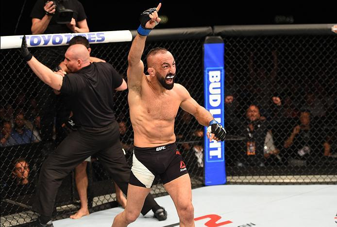 ROTTERDAM, NETHERLANDS - MAY 08:  (R-L) Reza Madadi celebrates his victory over Yan Cabral in their lightweight bout during the UFC Fight Night event at Ahoy Rotterdam on May 8, 2016 in Rotterdam, Netherlands. (Photo by Josh Hedges/Zuffa LLC/Zuffa LLC via