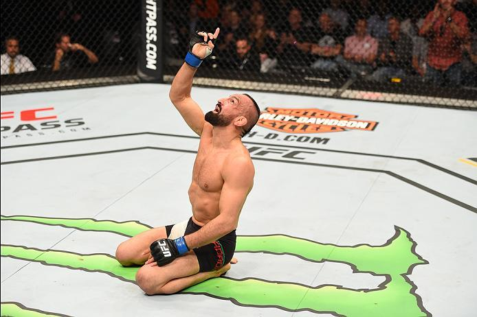 ROTTERDAM, NETHERLANDS - MAY 08:  Reza Madadi celebrates his victory over Yan Cabral in their lightweight bout during the UFC Fight Night event at Ahoy Rotterdam on May 8, 2016 in Rotterdam, Netherlands. (Photo by Josh Hedges/Zuffa LLC/Zuffa LLC via Getty