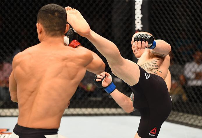 ROTTERDAM, NETHERLANDS - MAY 08:  (R-L) Josh Emmett kicks Jon Tuck in their lightweight bout during the UFC Fight Night event at Ahoy Rotterdam on May 8, 2016 in Rotterdam, Netherlands. (Photo by Josh Hedges/Zuffa LLC/Zuffa LLC via Getty Images)